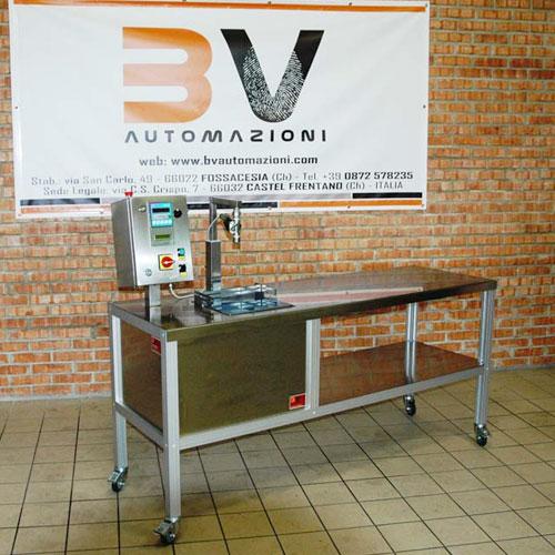 riempitrice semiautomatica olio con banco